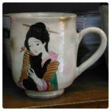 黒猫と女のマグカップ